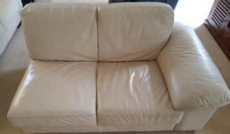 Leather Lounge Suite Cleaning, Clayfield, Brisbane - Halfway through cleaning a cream leather lounge suite in Clayfield, Brisbane. Look how much brighter the left hand side is.
